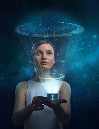 holography: Image of businesswoman of the future working with media screen