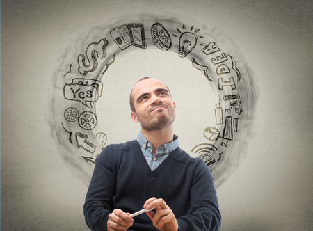Thinking businessman, sketch with business icons on the background photo