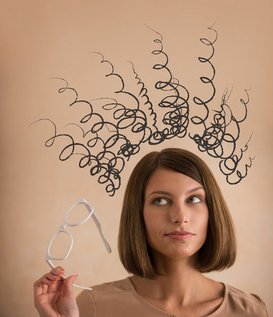Stress - woman stressed with headache caused by too many thoughts photo