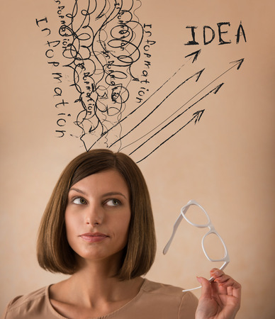 transforming: Young business woman converting experience, information and knowledge to ideas Stock Photo