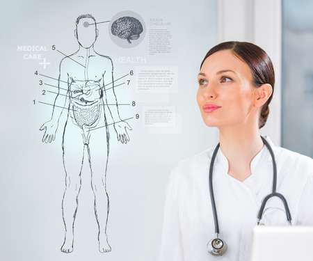 Female medical doctor working with virtual interface examining human male body photo