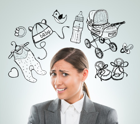 Young business woman thinking of her pregnancy plans closeup face portrait and sketches overhead photo