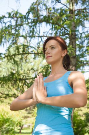 Yoga. Young woman doing yoga exercise outdoor photo