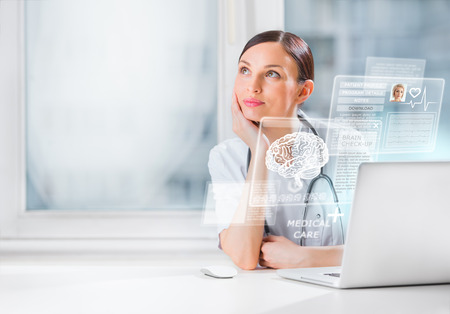 Female doctor scanning brain of patient with help of modern technology Stock Photo