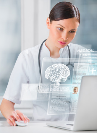 Female doctor scanning brain of patient with help of modern technology photo
