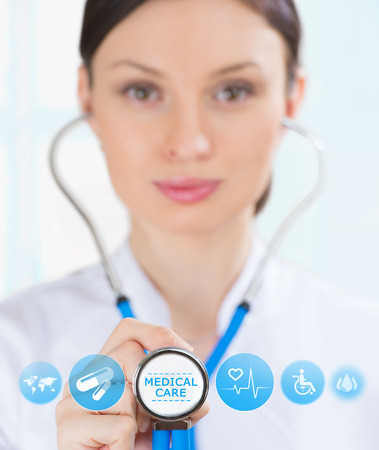 Female medical doctor working with healthcare icons. Modern medical technologies concept photo