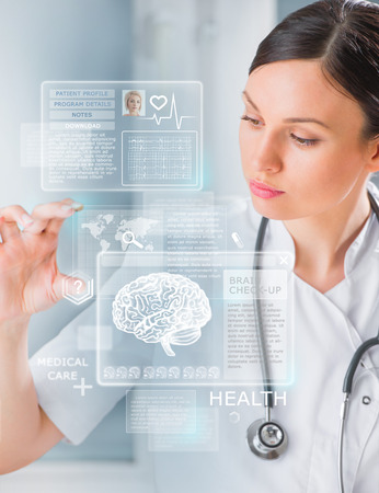 system: Calm doctor touching a medical interface in the hospital