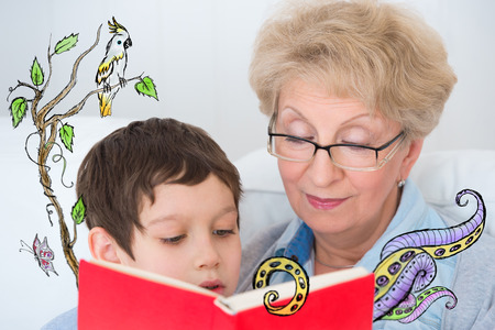 Grandmother and little boy reading book happy together at home. Sketches of imagination around them