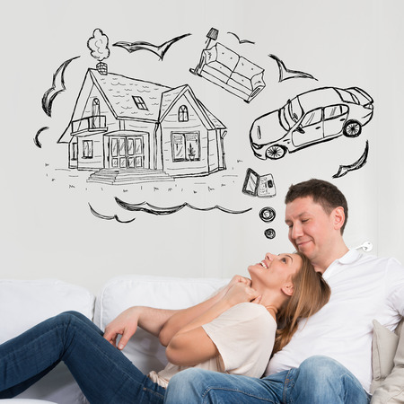 Mortgage and credit concept. Adult couple planning their future Фото со стока