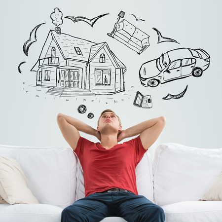 dream house: Mortgage and credit concept. Young man planning his future Stock Photo