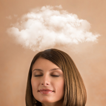 Close up of young woman with closed eyes and thought bubble above her head with copy space photo
