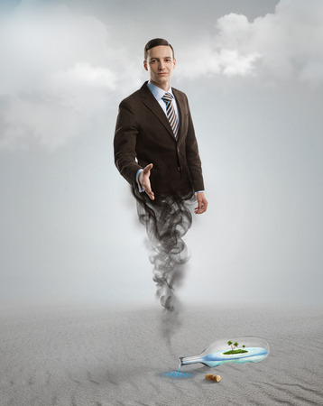 Genie business man appearing from the magic lamp or bottle. Help, assistance urgent solution concept photo