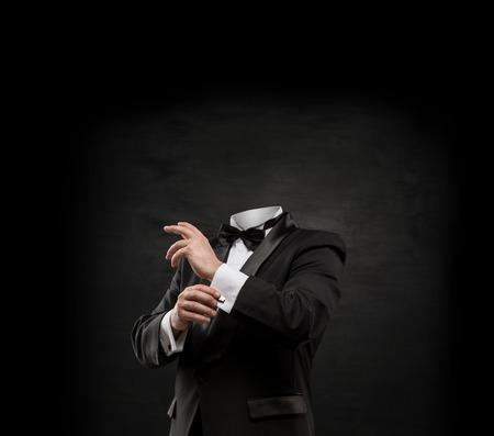 Man without head on dark concrete background photo