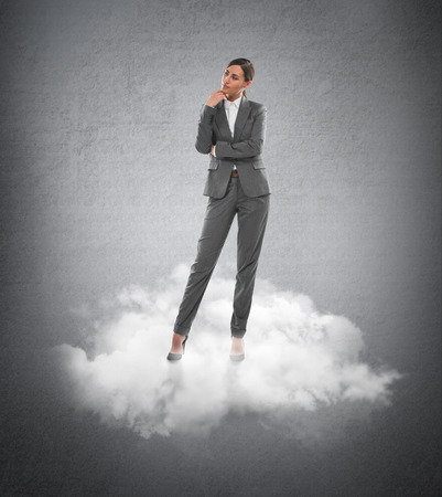hesitating: Young business woman standing on a cloud