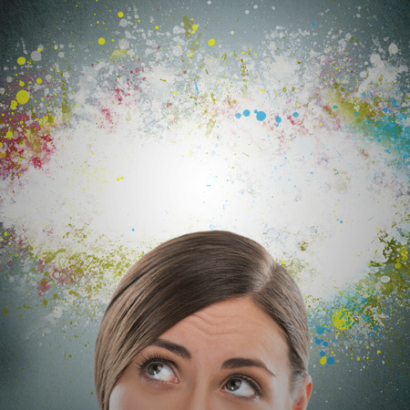 Colorful Thinking. Woman against gray background and colorful splashes with copyspace photo
