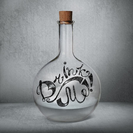 drink me: Glass bottle with liquid and vapor standing inside gray box. Drink Me sign drawn on the bottle. Magical doping concept