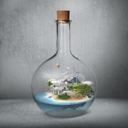 Corked glass bottle with beautiful island and sea inside. Microclimate, environment protection, quiet place concept