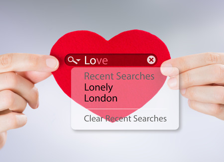 Love search. Female hands holding red heart with love search options photo