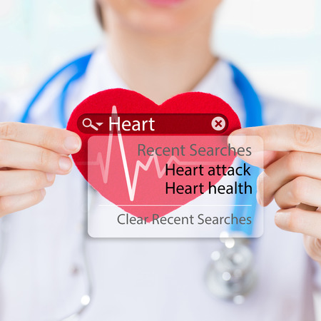 Doctor holding heart and heartbeat symbol with search engine and heart attack sign photo