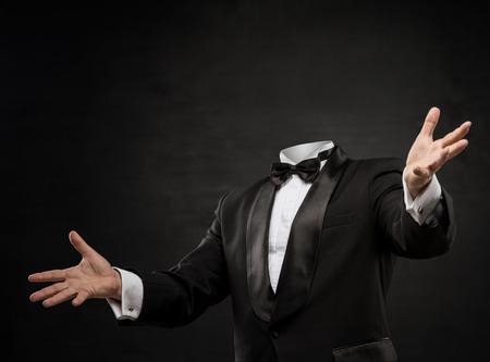 Man without head on dark background photo