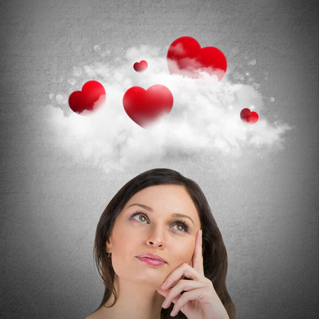 overhead: Red hearts flying in cloud overhead of beautiful dreamy woman. Valentines day background Stock Photo