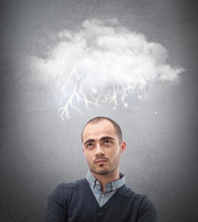 Stress, depression and despair - gloomy storm cloud raining above a businessman head photo