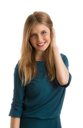 hesitating: Young girl wearing elegant dress posing against white background. Hesitating