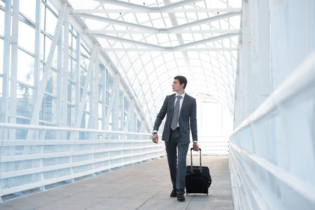 Man at the Airport with Suitcase photo