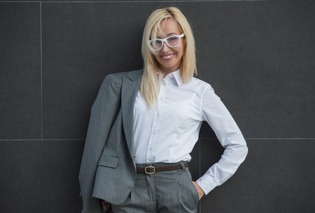 Portrait of elegantly dressed mature gorgeous blond business woman outdoor photo
