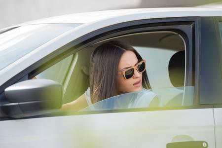 hot girl: Girl wearing sunglasses driving white car