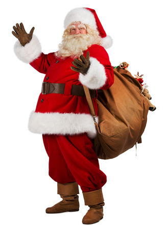 traditional gifts: Full length portrait of Real Santa Claus carrying big bag full of gifts, isolated on white background