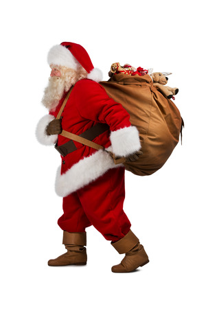 father christmas: Santa Claus on the run to delivery christmas gifts isolated on white background Stock Photo