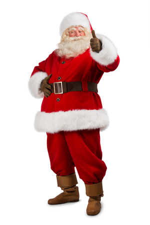 look up: Santa Claus standing isolated on white background and thumbs up - full length portrait