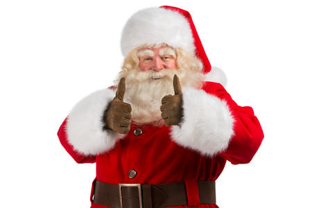 look up: Santa Claus standing isolated on white background and thumbs up
