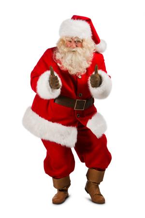 Santa Claus status geïsoleerd op witte achtergrond en duimen omhoog - volledig lengteportret Stockfoto