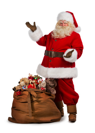 leather bag: Full length portrait of a Santa Claus posing near a bag full of gifts isolated on white background