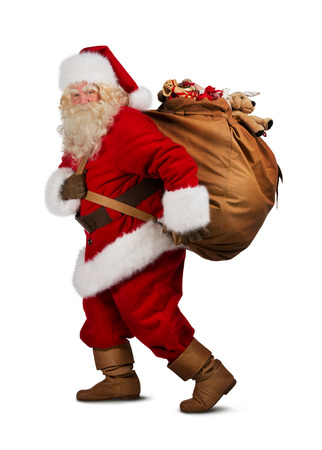 Santa Claus on the run to delivery christmas gifts isolated on white background Imagens - 31533050