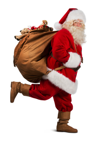 to santa: Santa Claus on the run to delivery christmas gifts isolated on white background Stock Photo