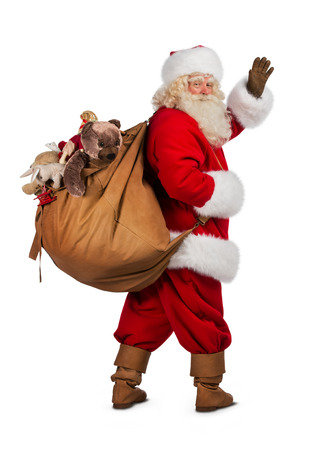 santa hand: Real Santa Claus carrying big bag full of gifts, isolated on white background Stock Photo