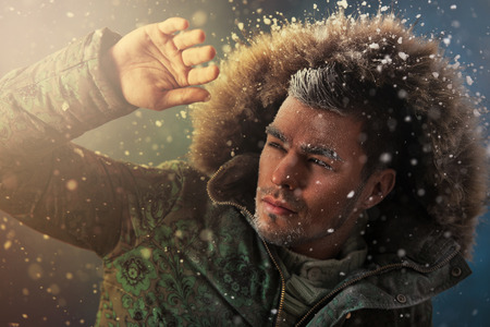 manly man: Portrait of brutal sexy man outdoors in winter under snowstorm Stock Photo