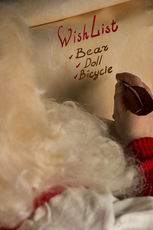 wishlist: Close-up of Christmas wishlist letter in Santa Claus hands Stock Photo