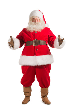 Happy Christmas Santa Claus with a welcome gesture. Isolated on white background. Full length