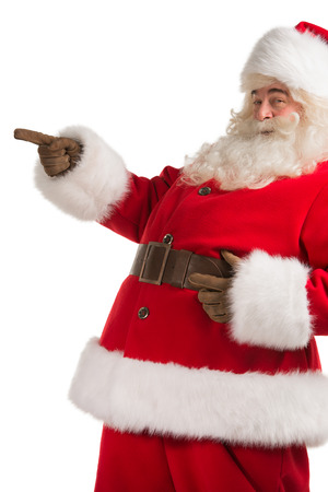 Santa Claus gesturing his hand isolated over white background. Presenting something photo