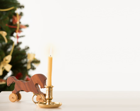 Vintage Wooden Horse on Santas work table, Christmas Tree on background photo