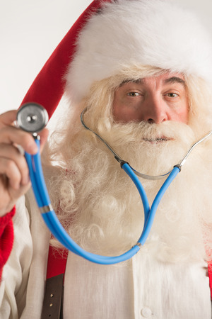 Santa Claus Doctor using a stethoscope
