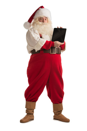 Santa Claus showing tablet computer display isolated full length portrait on white background photo