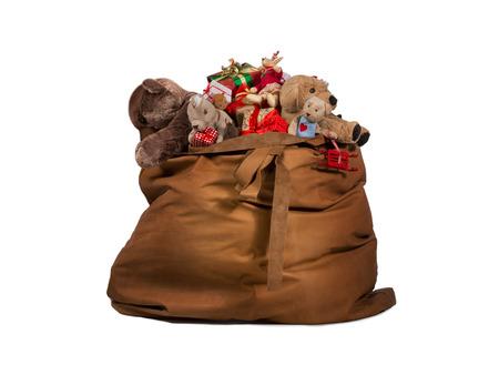 Kerstman cadeau zak vol speelgoed en geschenken geïsoleerd op witte achtergrond Stockfoto