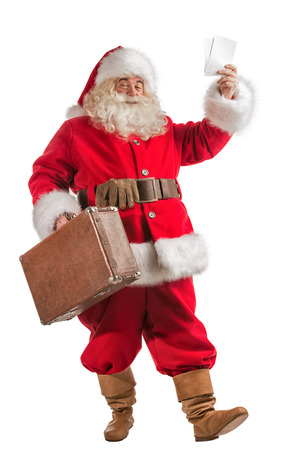 Santa Claus with old leather suitcase isolated on white background. Travel concept or postal delivery service. Full length portrait photo