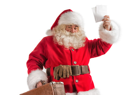 Santa Claus with old leather suitcase isolated on white background. Travel concept or postal delivery service. photo