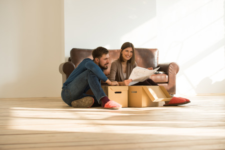 moving house: Young couple moving in new house